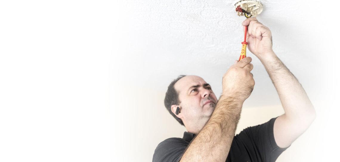 Fantastic Handyman Professional Doing Electrical Work
