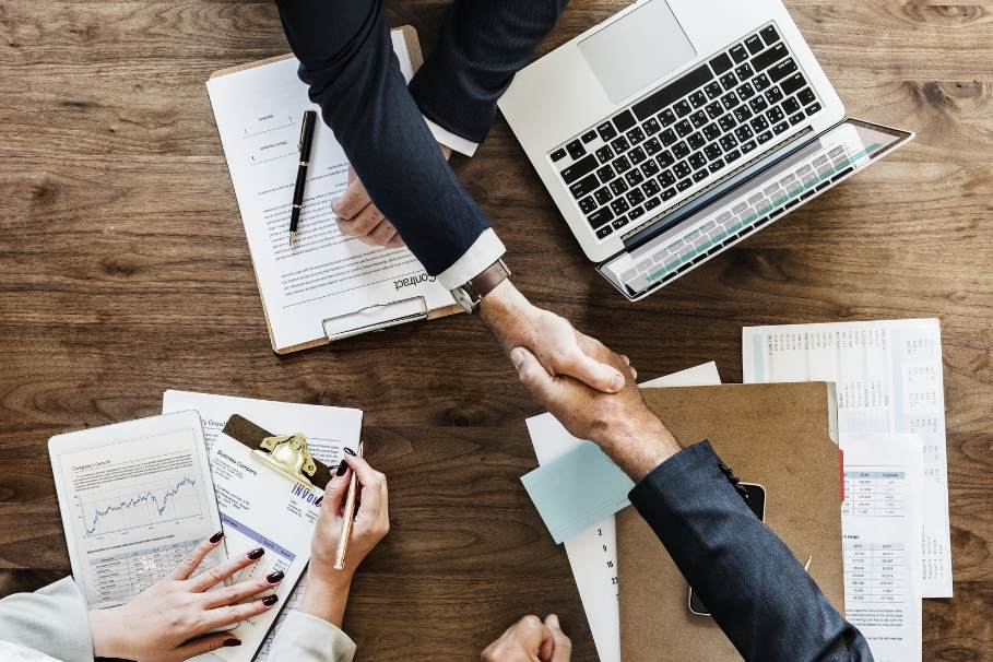 a handshake over the desk
